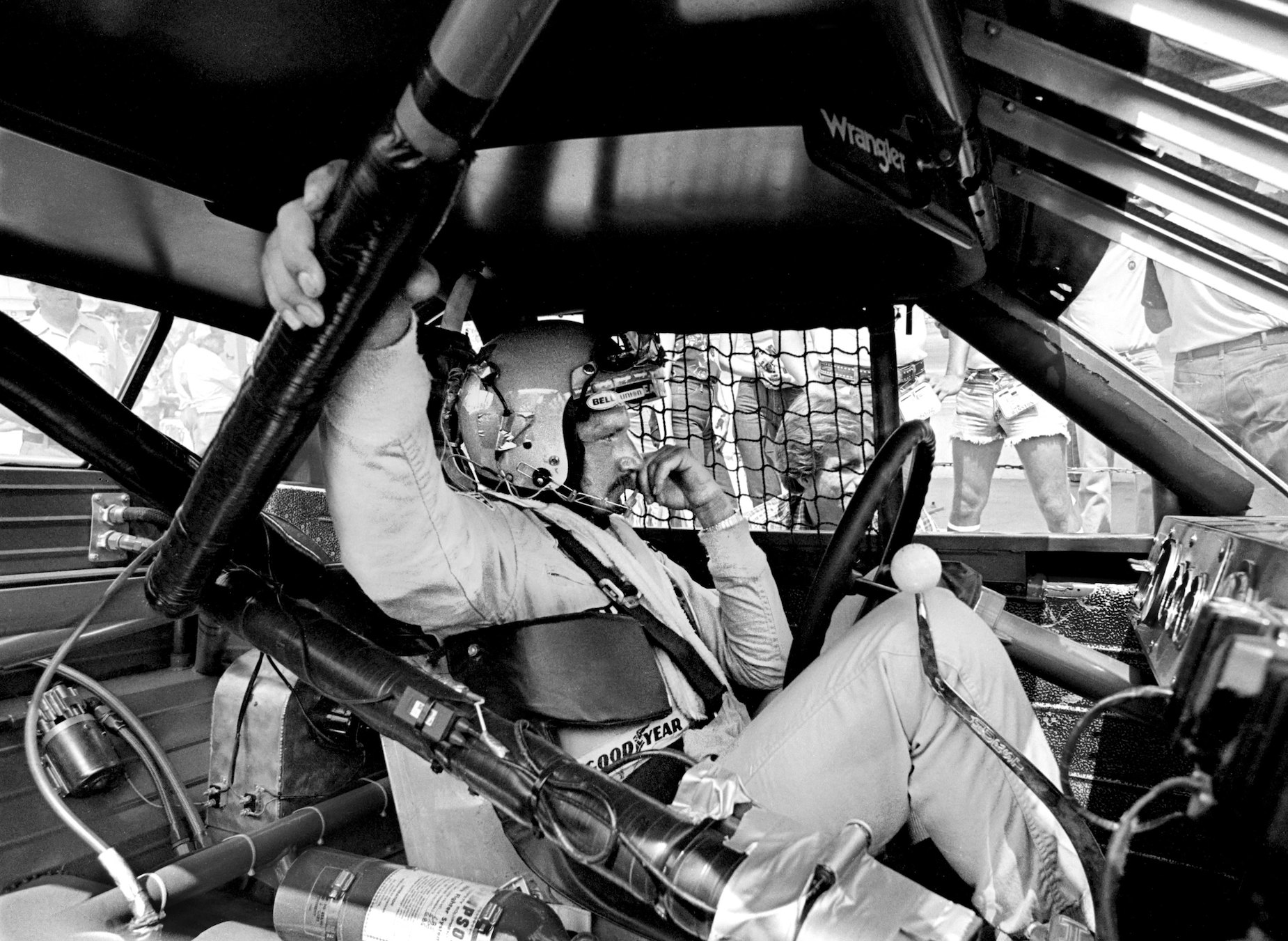 NASCAR star Dale Earnhardt sits in his stock car in 1981.