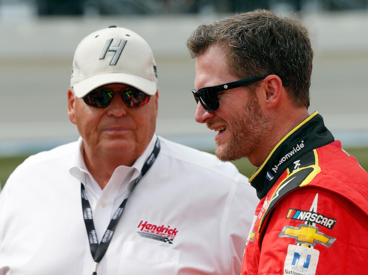 Dale Earnhardt Jr. and Rick Hendrick talk before race.