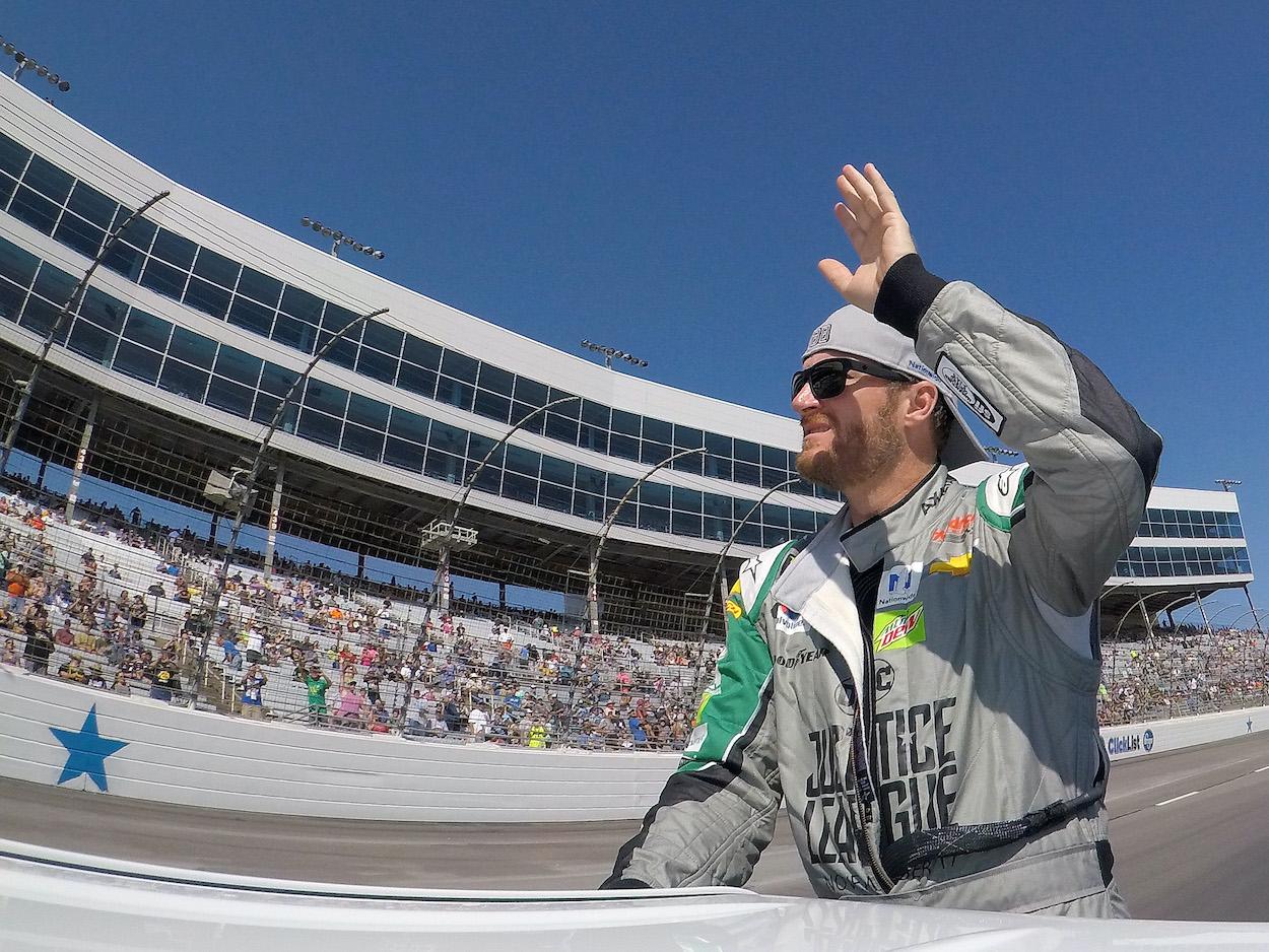 Dale Earnhardt Jr. waves to the NASCAR crowd