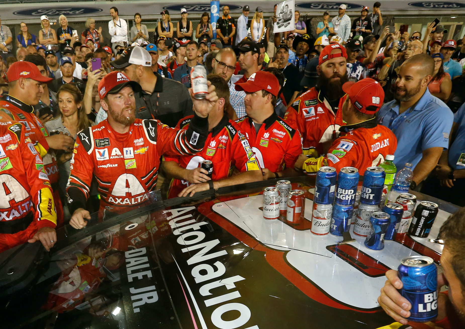 Dale Earnhardt Jr. celebrates a NASCAR win with a beer