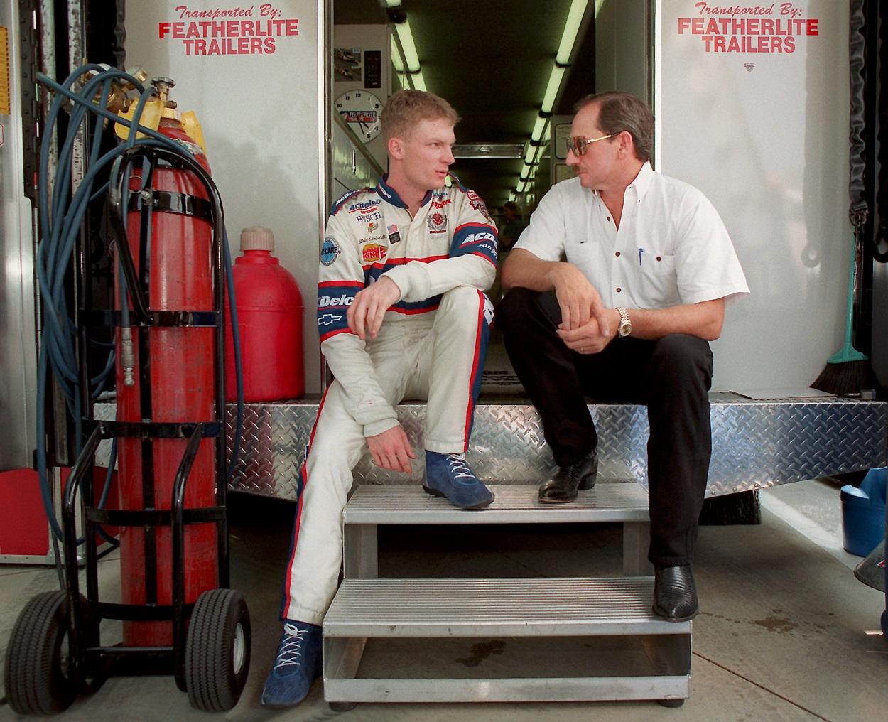 Dale Earnhardt Jr. and Dale Earnhardt Sr. talking before Carquest 300 Grand National qualification.