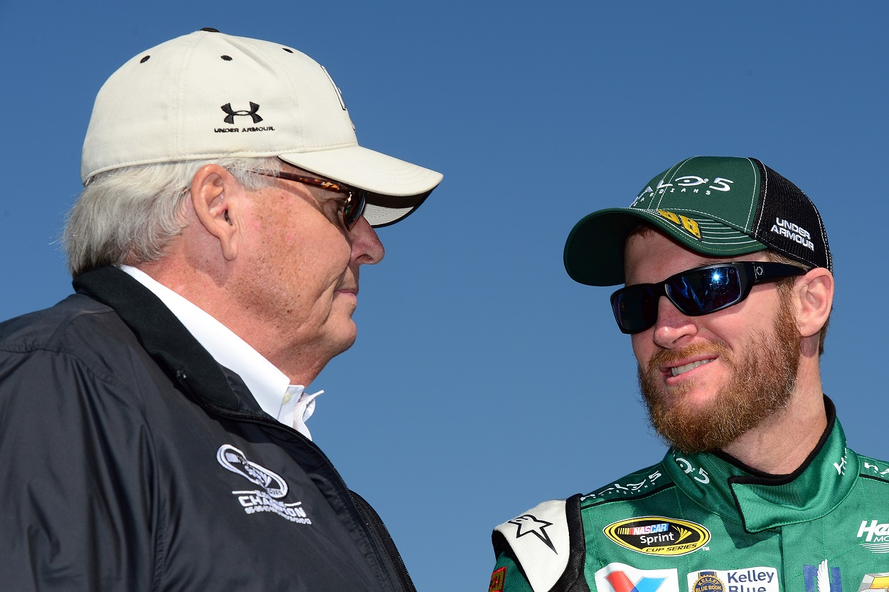 Dale Earnhardt Jr. and Rick Hendrick talk to each other before a NASCAR race.
