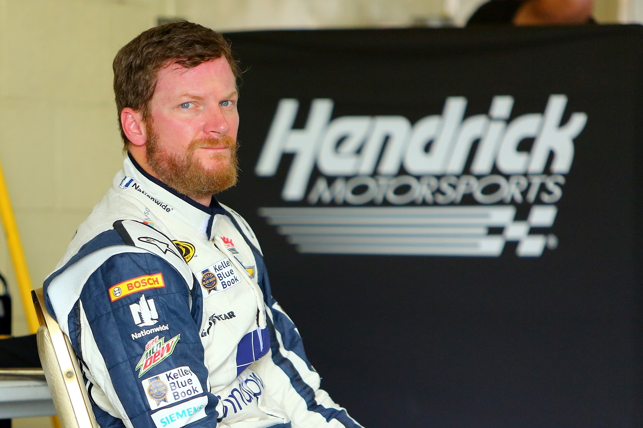 Dale Earnhardt Jr. waits in the garage before a Cup Series race.