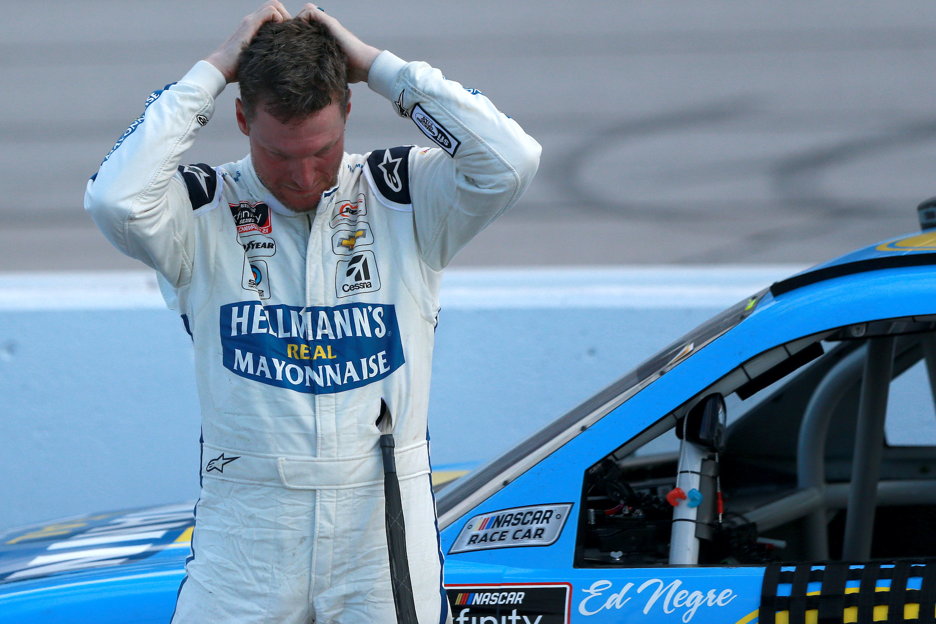 NASCAR star Dale Earnhardt Jr. holds his hands behind his head.