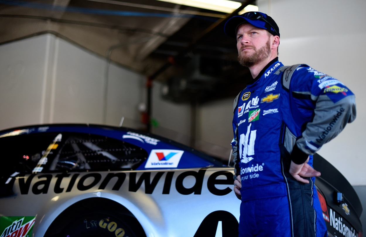 Dale Earnhardt Jr. looks on in the garage area during practice for the NASCAR Sprint Cup Series Daytona 500