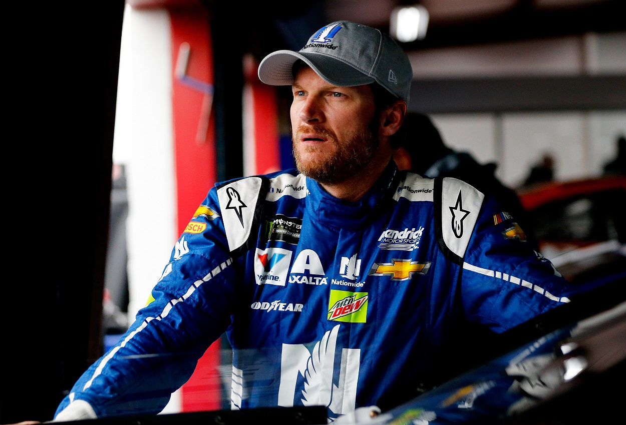 Dale Earnhardt Jr. stands in the garage before a NASCAR race.