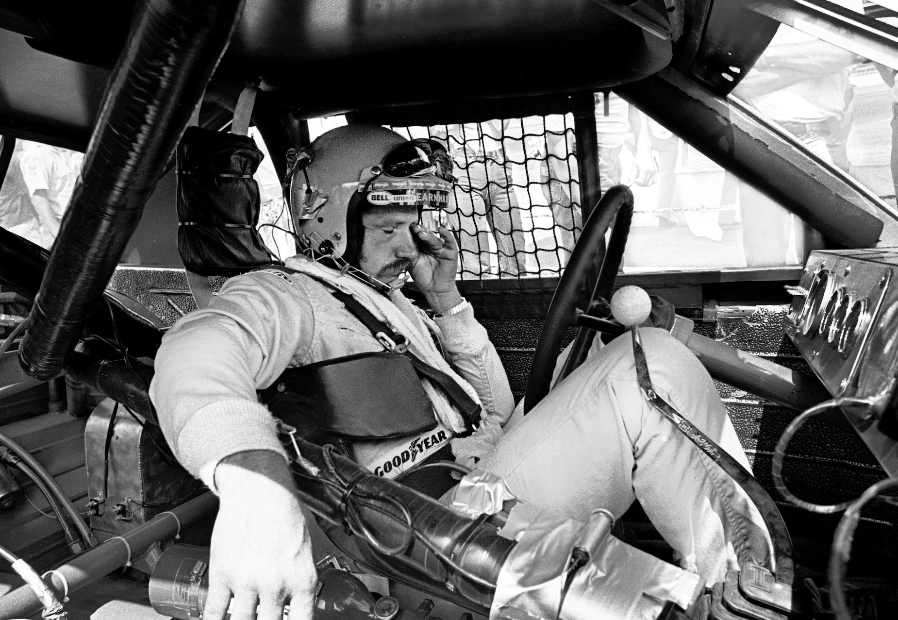 NASCAR legend Dale Earnhardt sits in the driver's seat