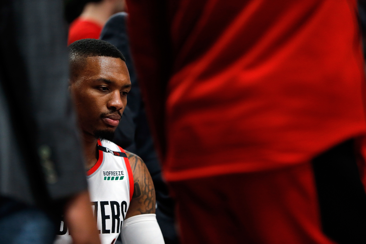 Portland Trail Blazers guard Damian Lillard sits on the bench during a game