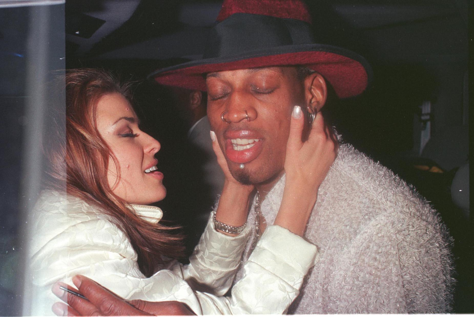 Dennis Rodman and Carmen Electra embrace in Beverly Hills during their time together.