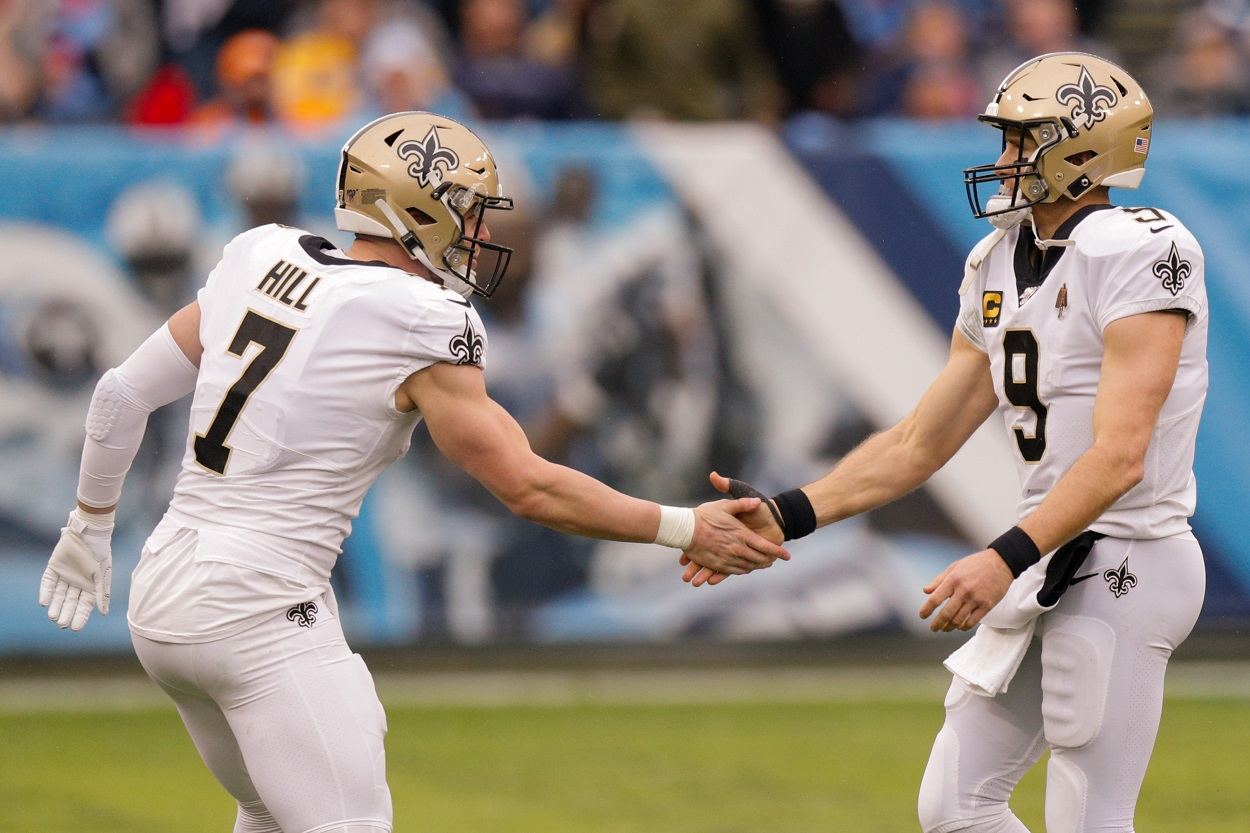 Drew Brees and Taysom Hill celebrate during an NFL game.