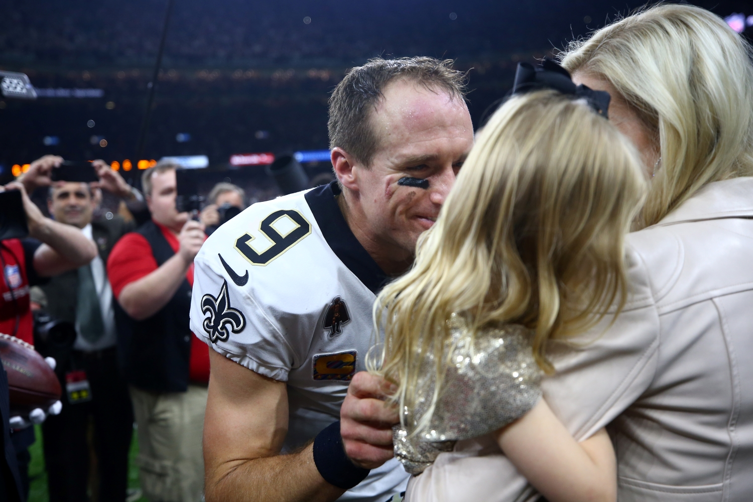 New Orleans Saints quarterback Drew Brees celebrates with his family after he broke the NFL's all-time passing yards record on Oct. 8, 2018.