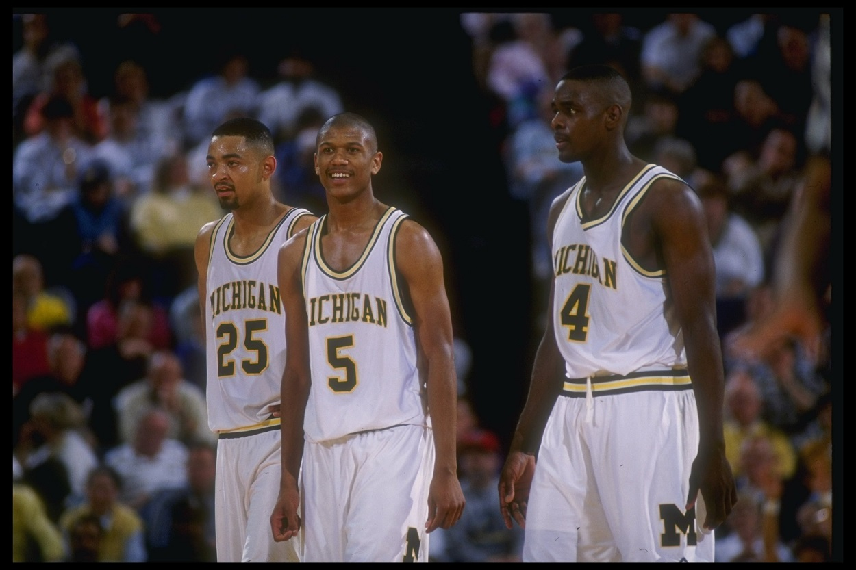 Three of the Michigan Wolverines' famed 'Fab Five,' Juwan Howard, Jalen Rose, and Chris Webber in 1992