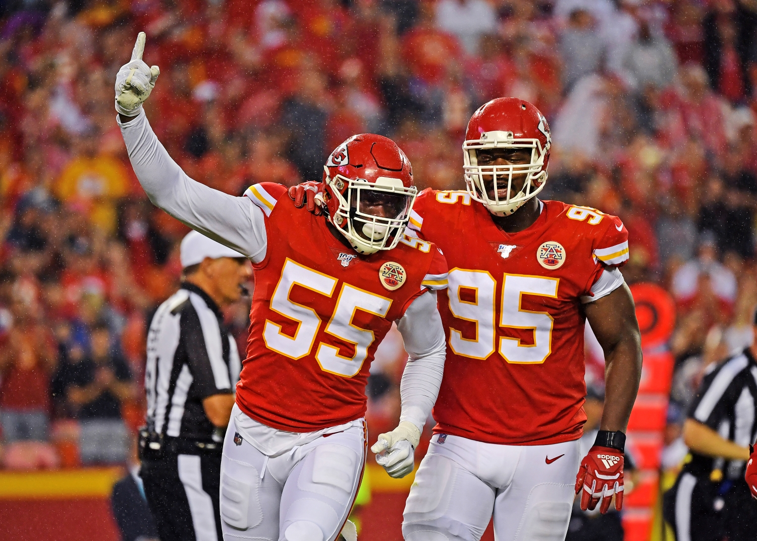 Frank Clark of the Kansas City Chiefs celebrates alongside teammate Chris Jones during a preseason game in 2019.