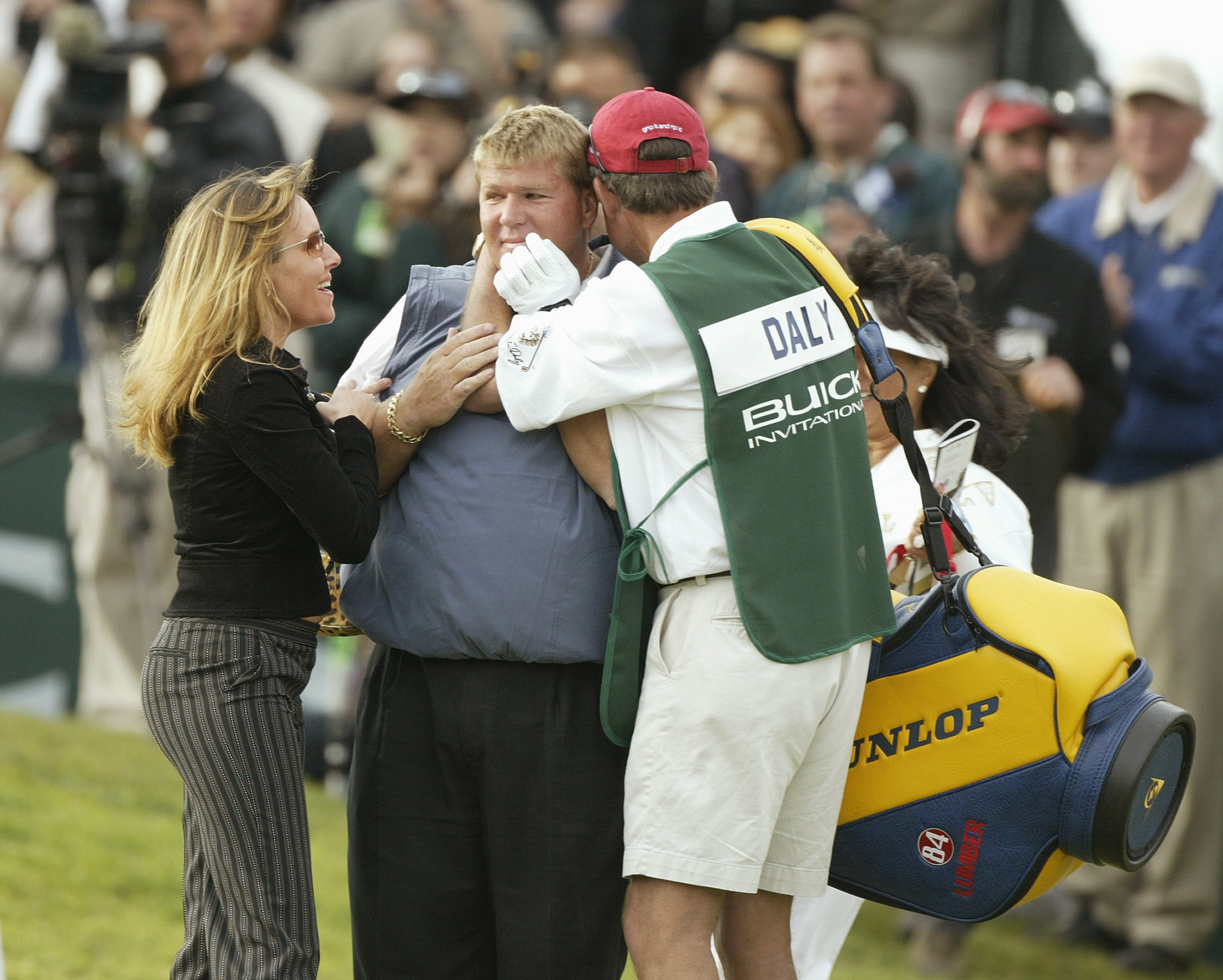 John Daly with his wife Sherrie Daly and caddie after winning the 2004 Buick Invitational
