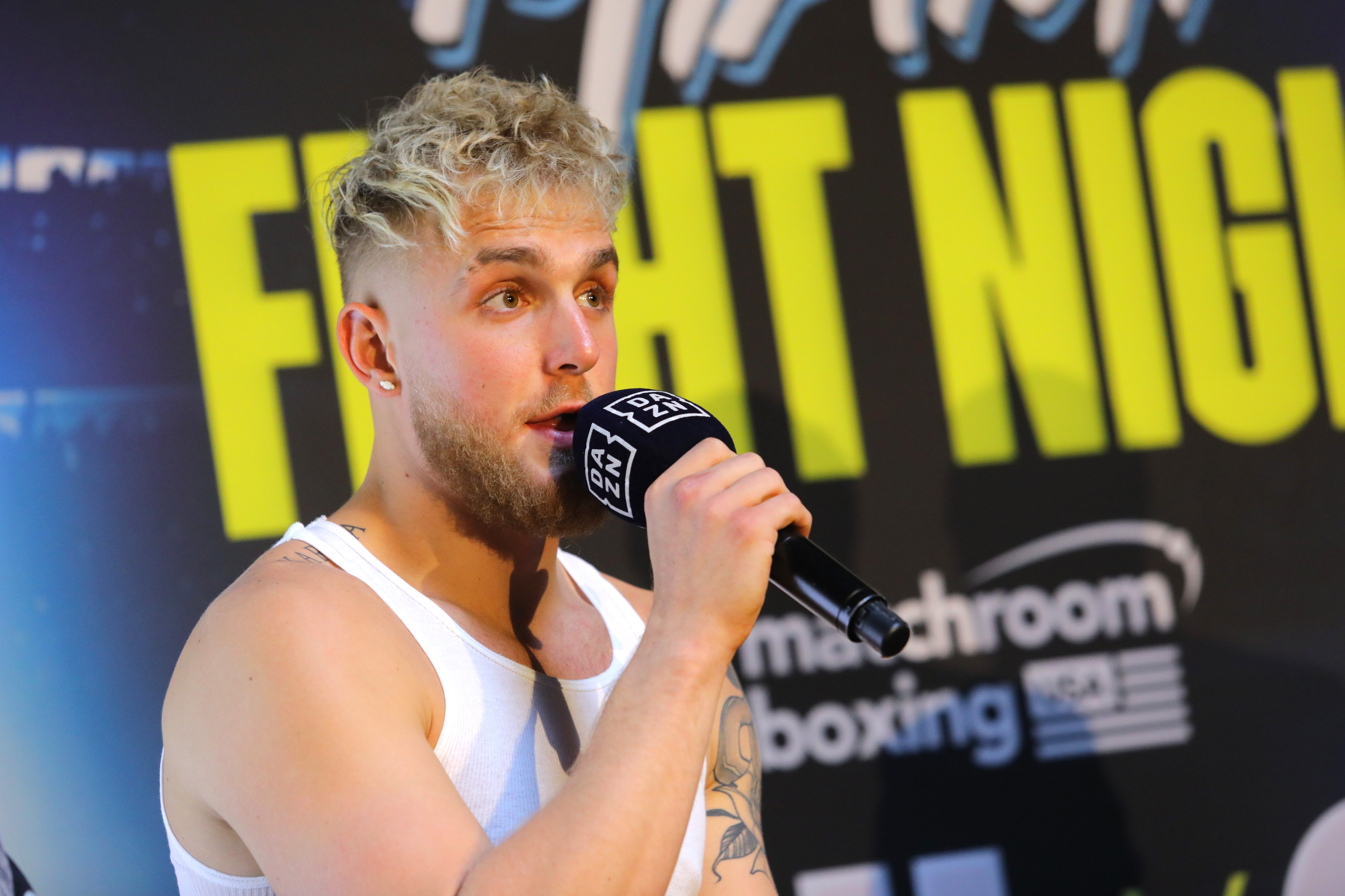 Jake Paul talking on stage before a fight