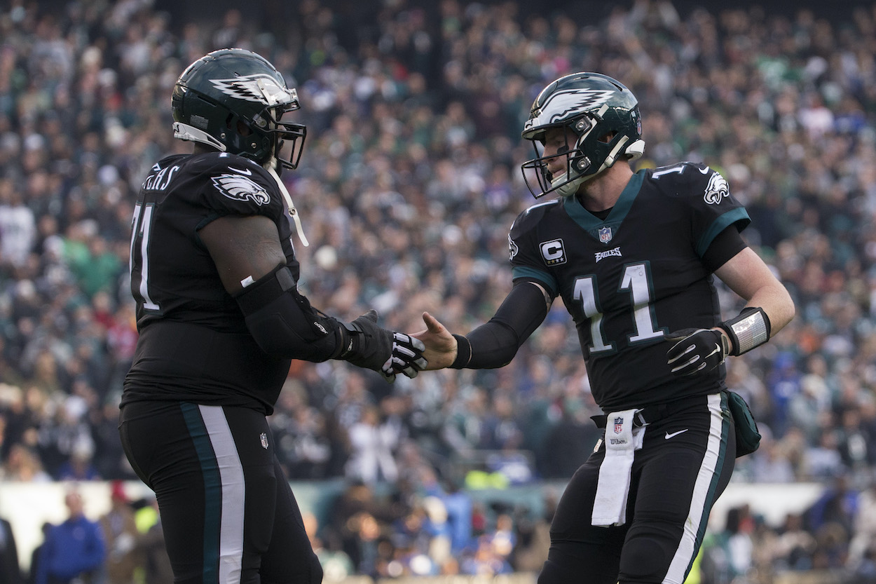 Jason Peters and Carson Wentz shake hands