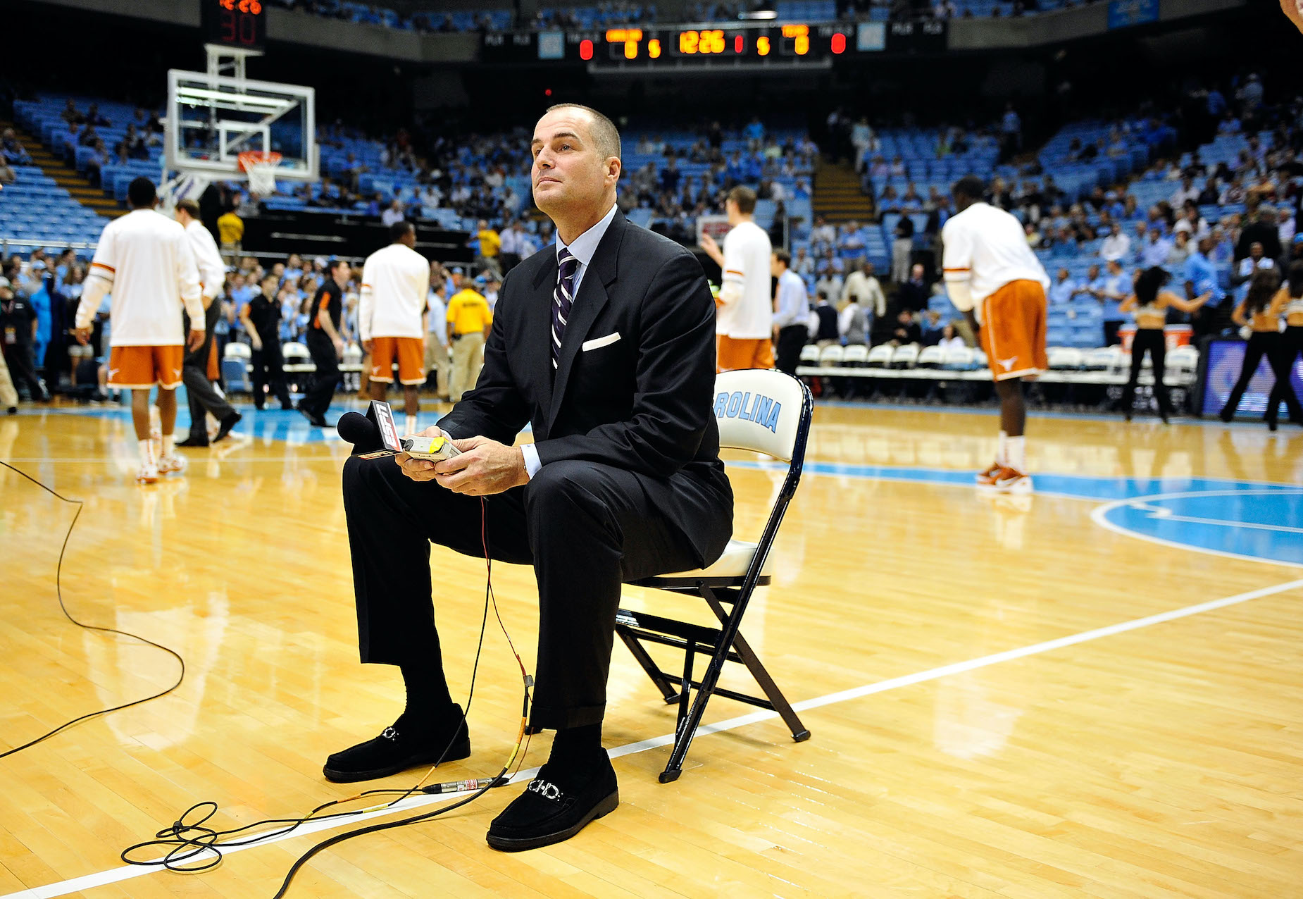 Former player turned ESPN analyst Jay Bilas sits on the court pregame