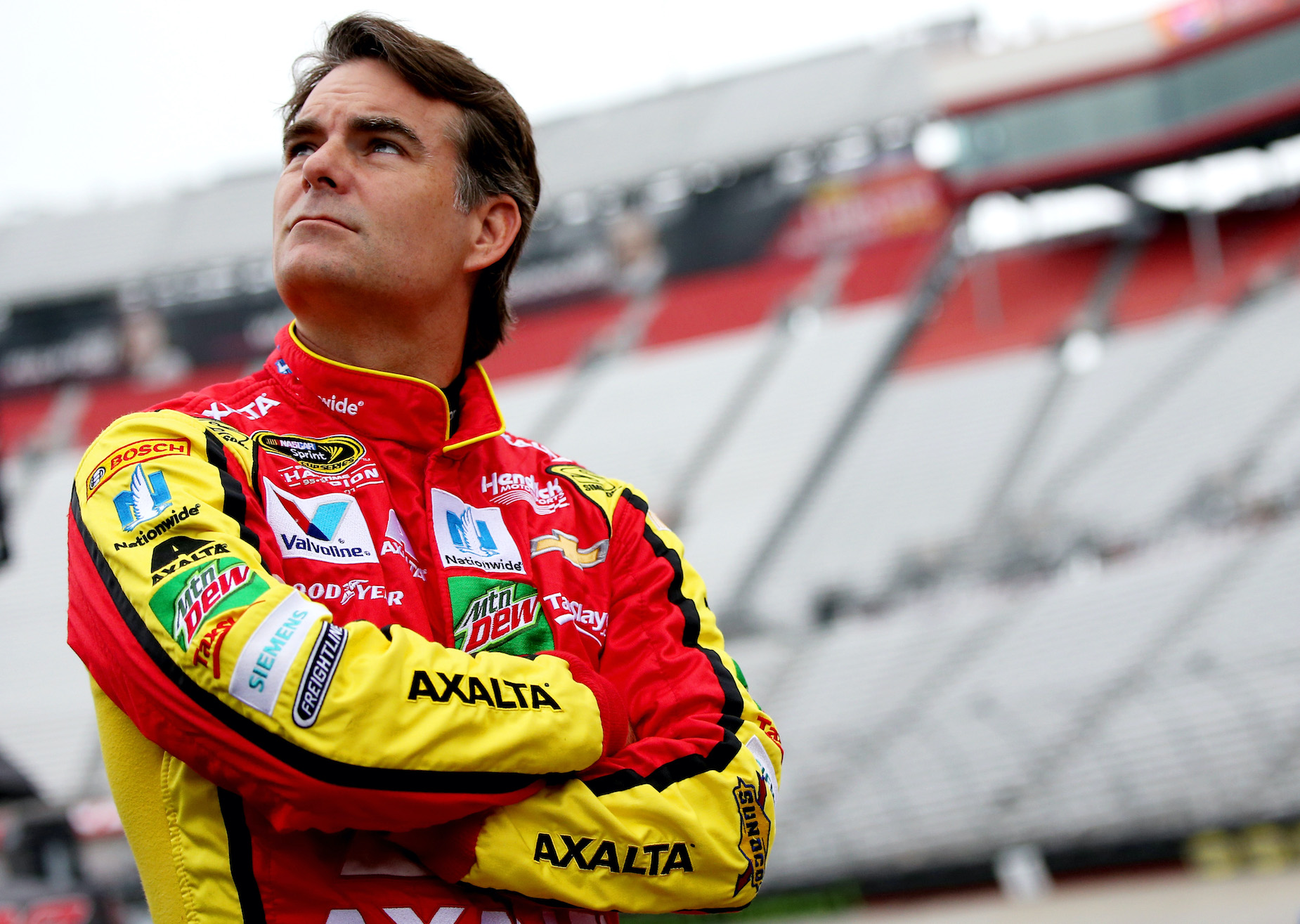 NASCAR star Jeff Gordon stands outside of his car during practice.