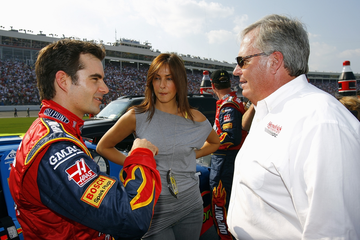 Jeff Gordon, driver of the #24 DuPont Chevrolet, talks with his girlfriend Ingrid Vandebosch and car owner Rick Hendrick before the NASCAR Nextel Cup Series Coca-Cola 600 at the Lowe's Motor Speedway on May 28, 2006.