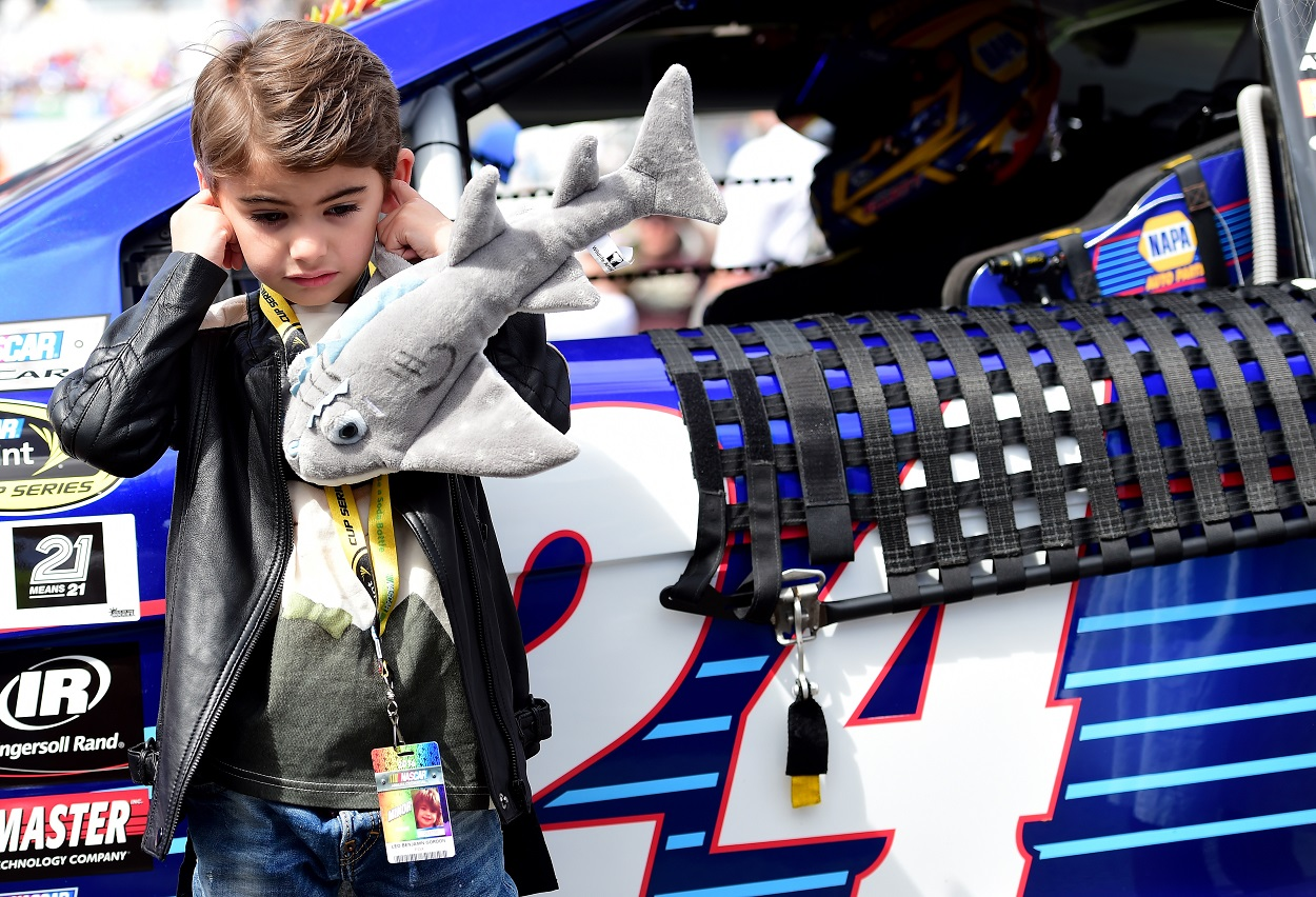 Jeff Gordon's son Leo stands by his car.