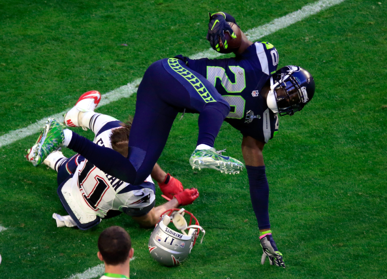 Jeremy Lane being tackled after getting an interception