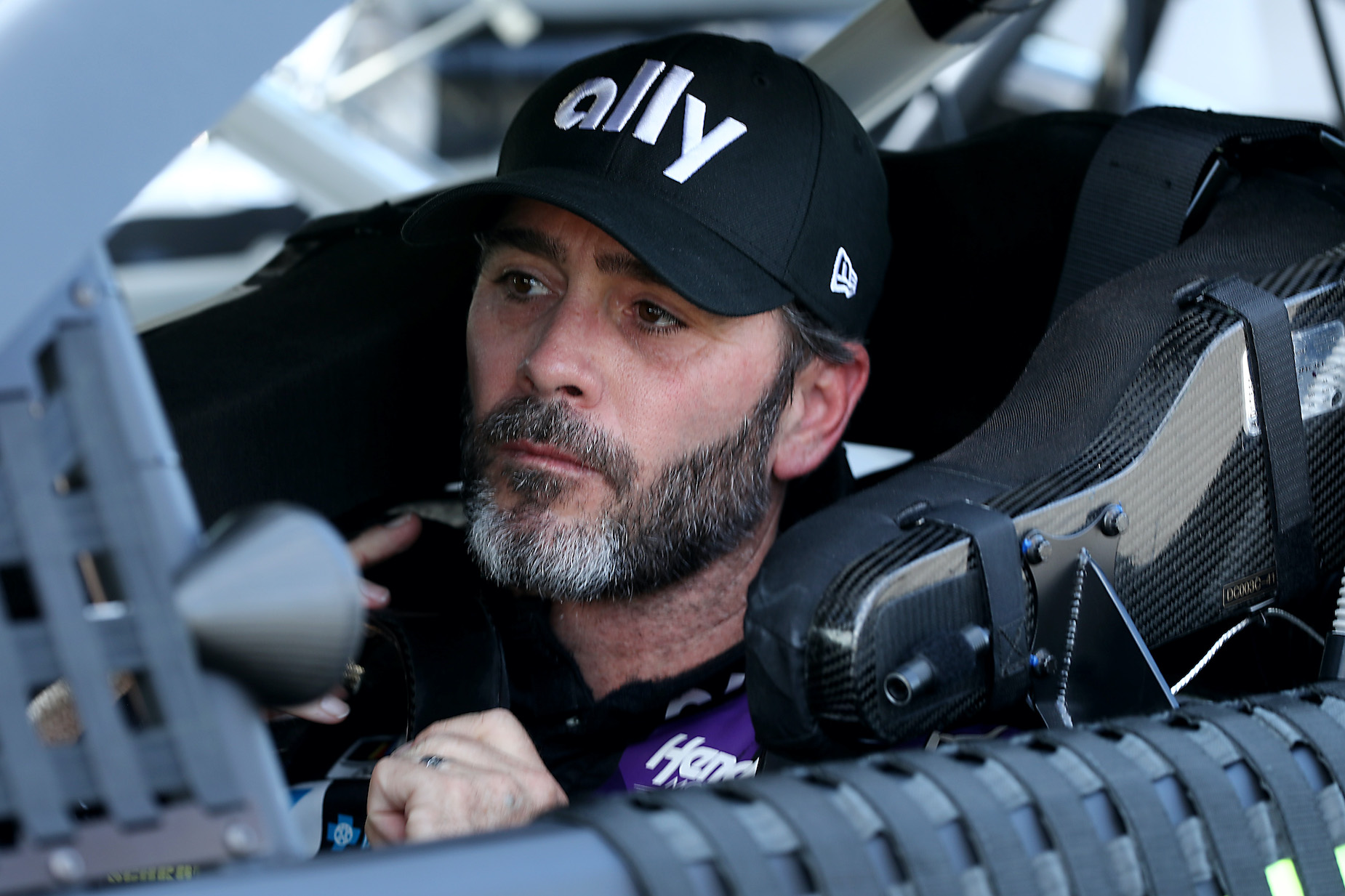 NASCAR driver Jimmie Johnson sits in the driver's seat