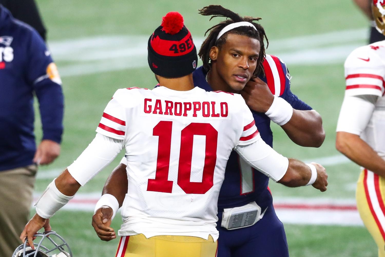 San Francisco 49ers quarterback Jimmy Garoppolo embraces New England Patriots quarterback Cam Newton.