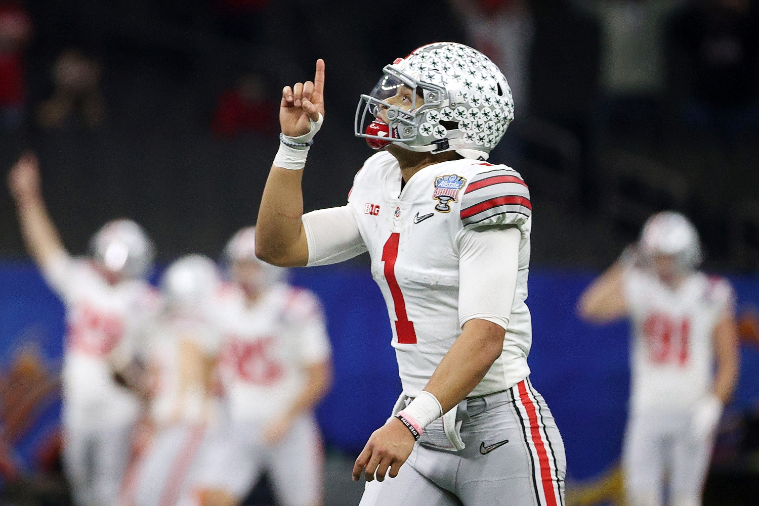 Ohio State quarterback Justin Fields reacts after throwing a touchdown pass during the 2021 College Football Playoff semifinal on New Year's Day.