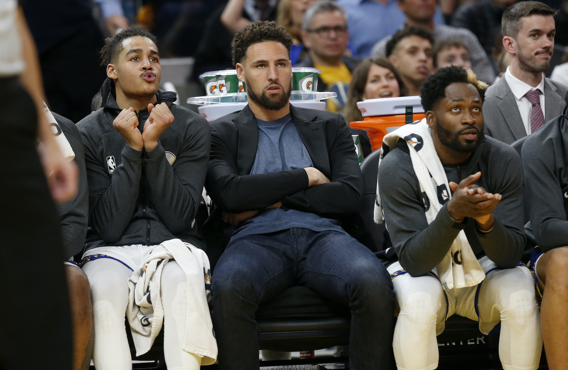 Golden State Warriors star Klay Thompson watches from the sidelines as he recovers from an injury