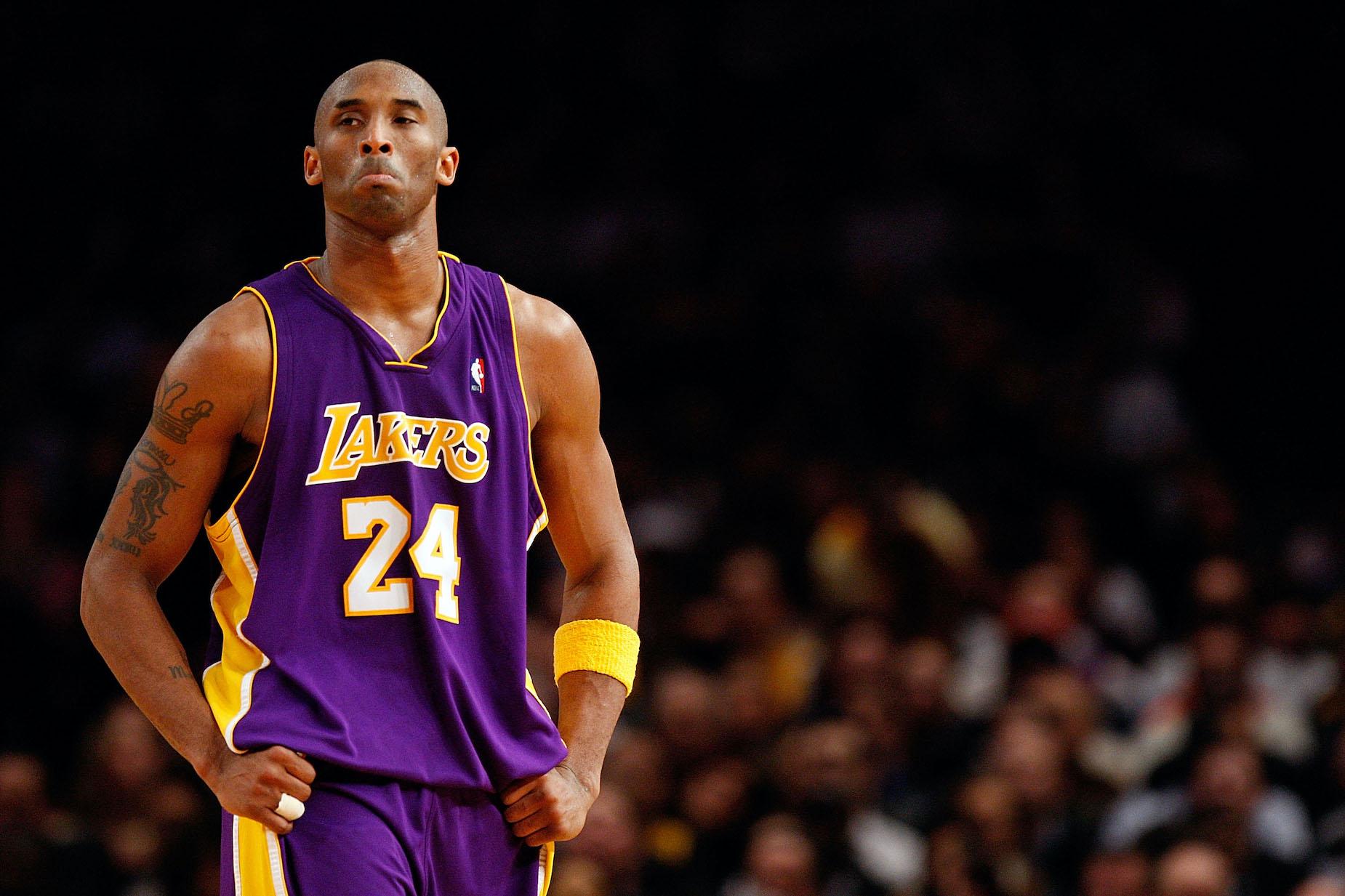 LA Lakers star Kobe Bryant walks down the court
