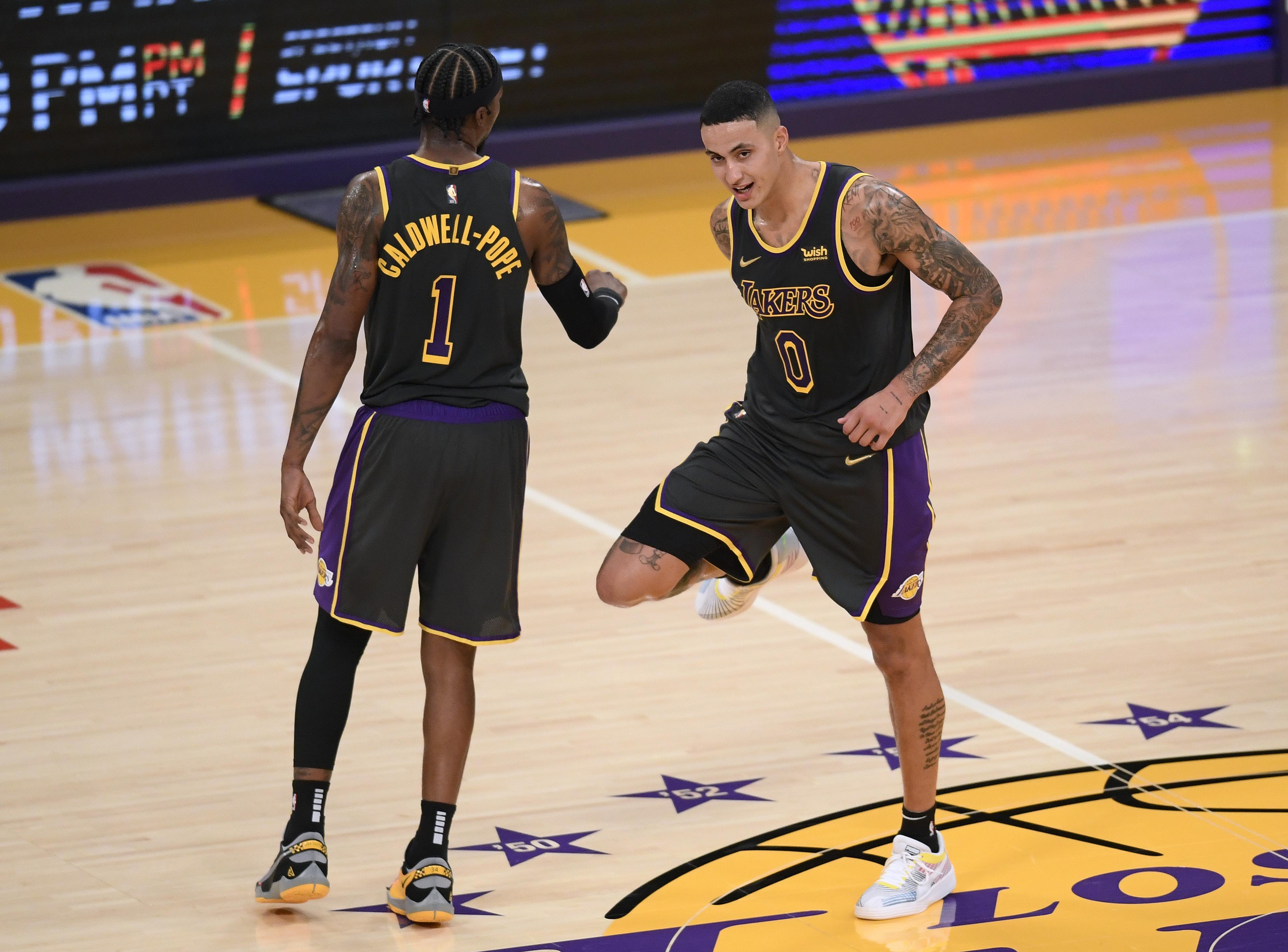 Kyle Kuzma and Kentavious Caldwell-Pope celebrate a Lakers win