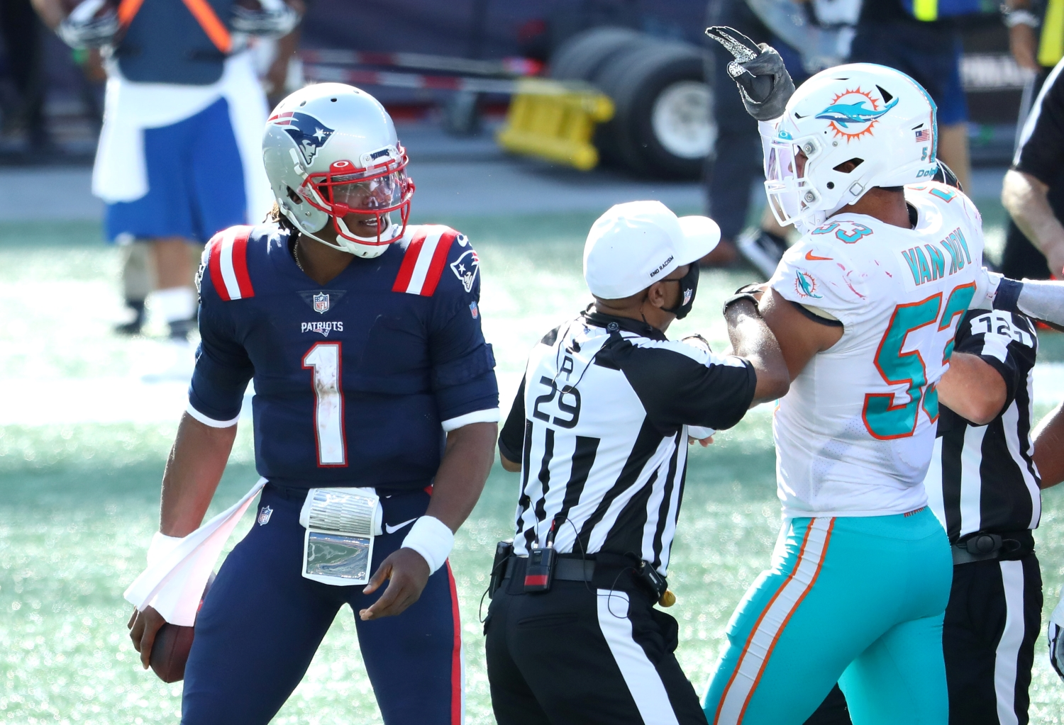 Cam Newton of the New England Patriots and Kyle Van Noy of the Miami Dolphins are involved in an altercation following their game at Gillette Stadium on September 13, 2020.