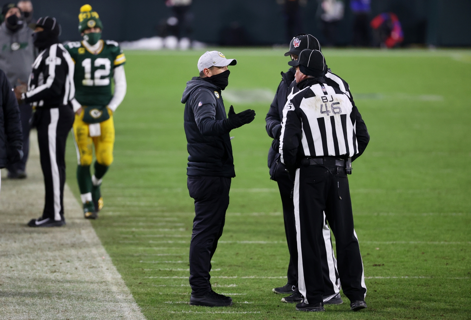 Aaron Rodgers paces the sidelines as Packers head coach Matt LaFleur speaks to the referees in the fourth quarter of the NFC championship game at Lambeau Field on Jan. 24, 2021.