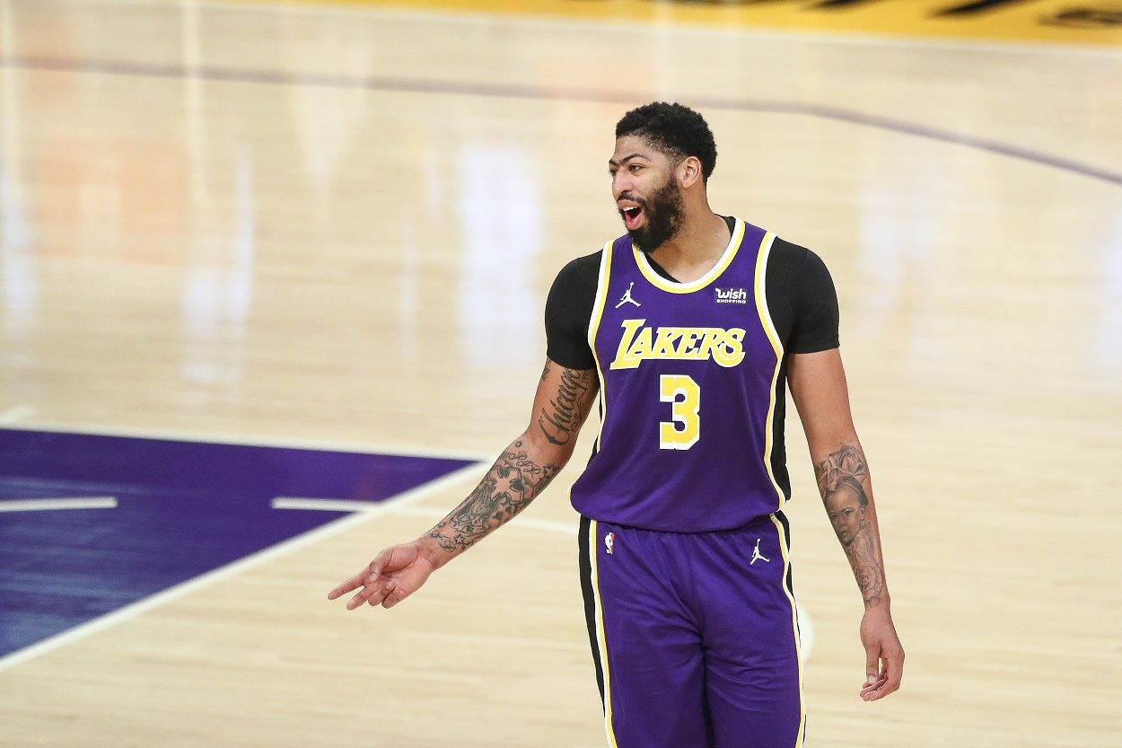 Lakers Anthony Davis reacts to a play during a game.