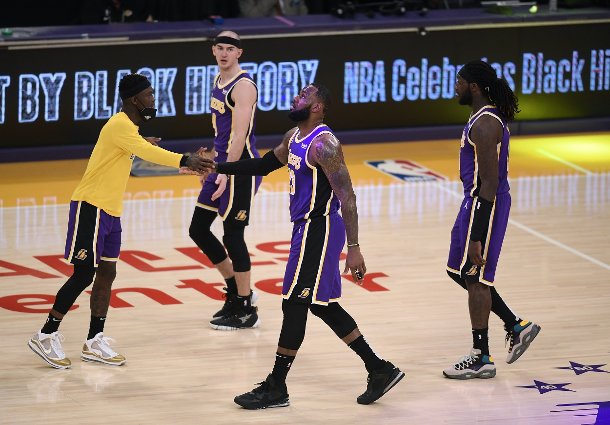 Lakers players react after a play during an NBA game.