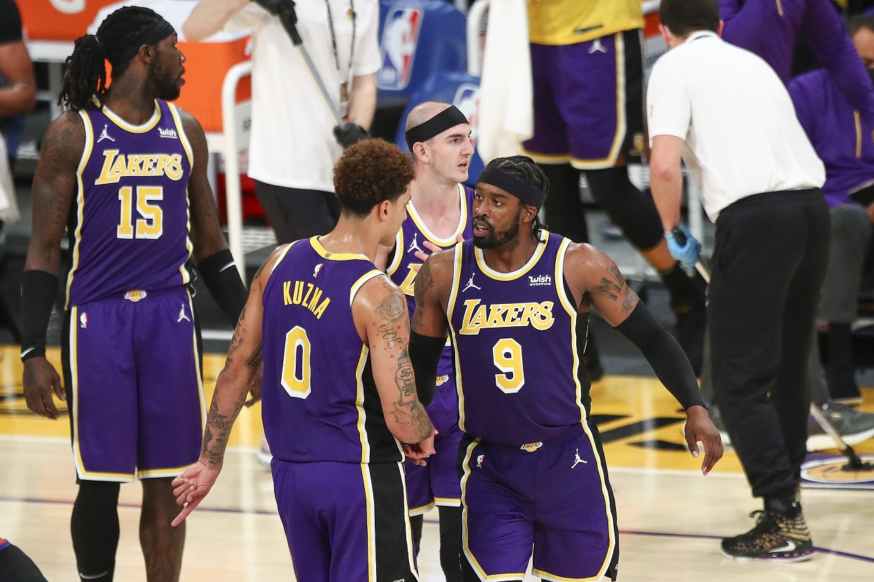 Lakers players react to a play during a game.