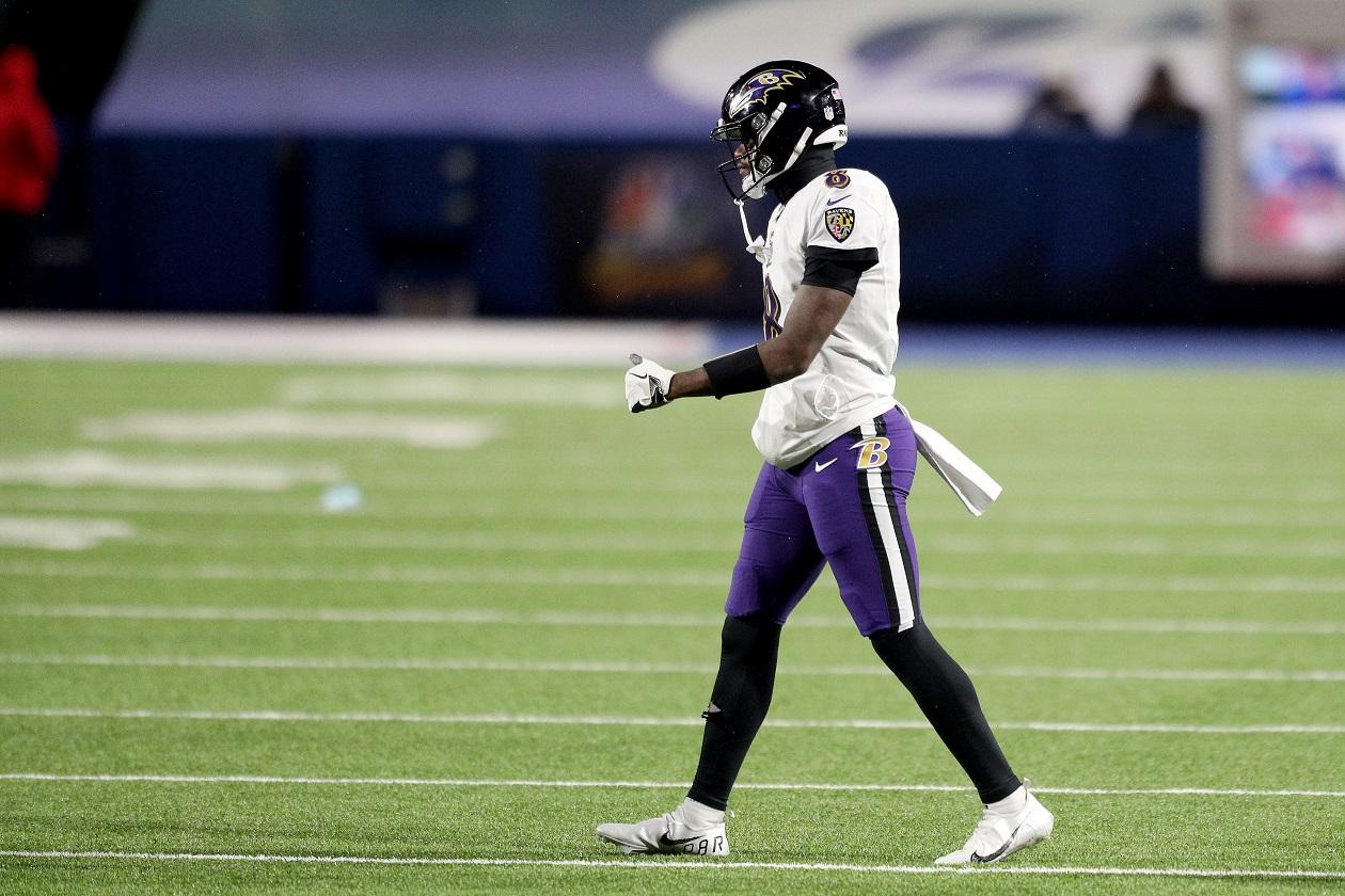 Baltimore Ravens QB Lamar Jackson walks onto the field