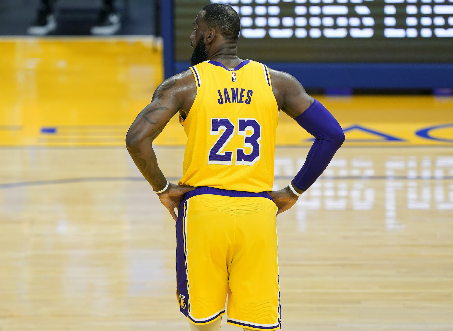 LeBron James stands on the court for the LA Lakers.