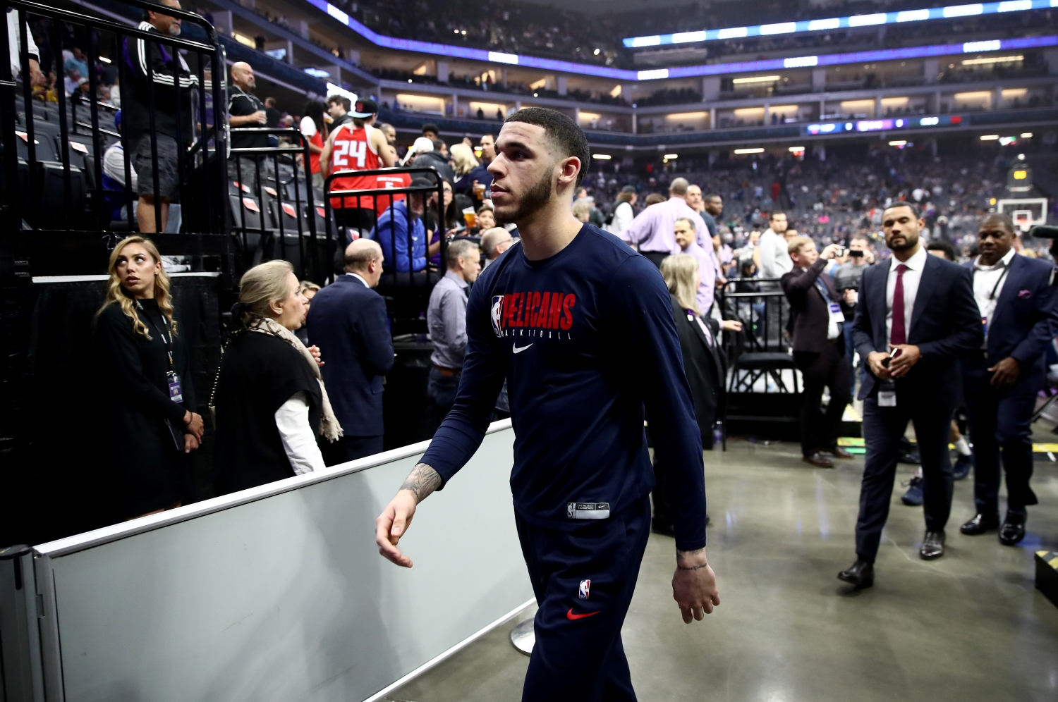New Orleans Pelicans guard Lonzo Ball walks off the court after a game against the Sacramento Kings was postponed.