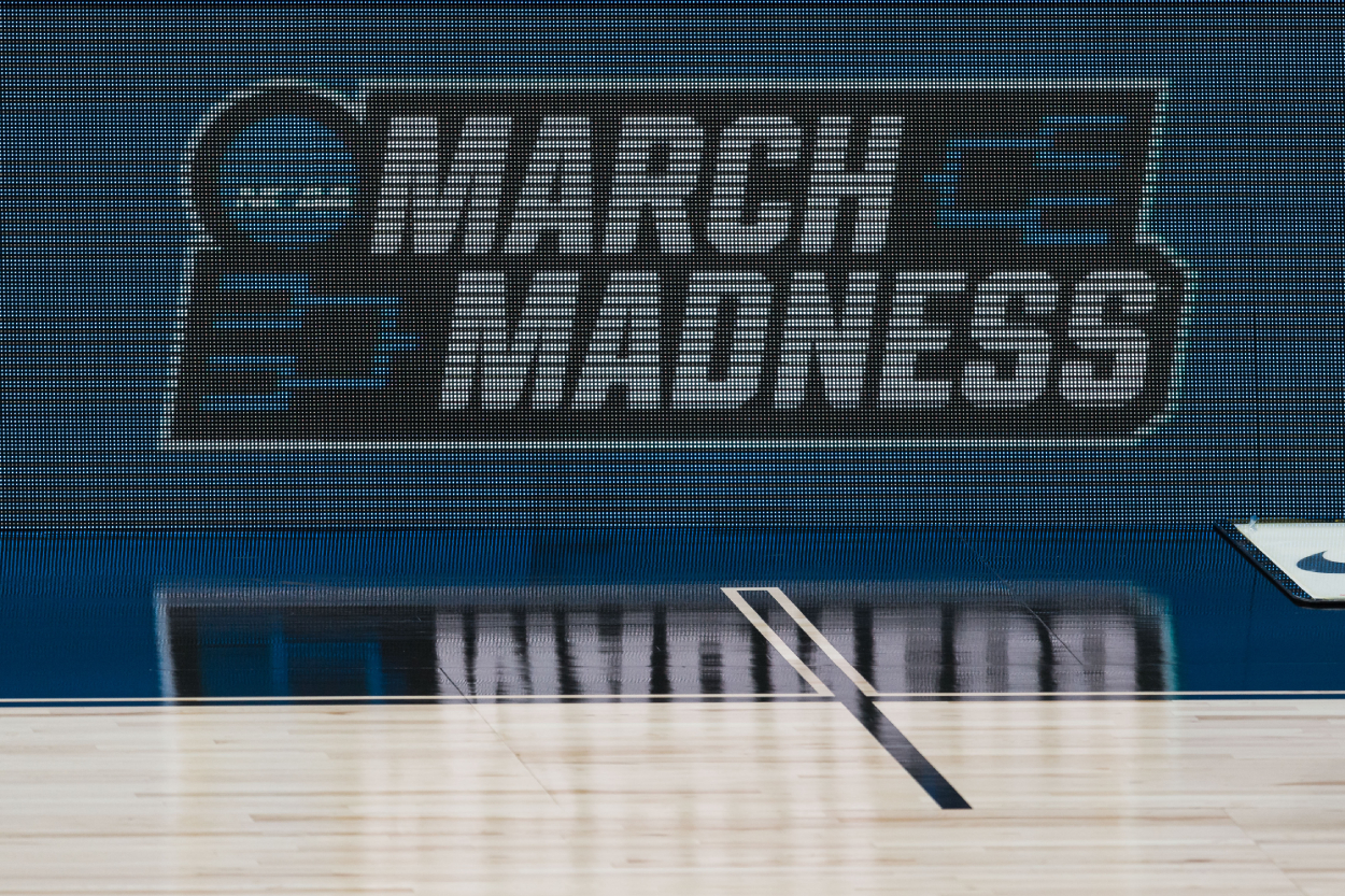 An NCAA March Madness sign hangs in the stands during a college basketball gme