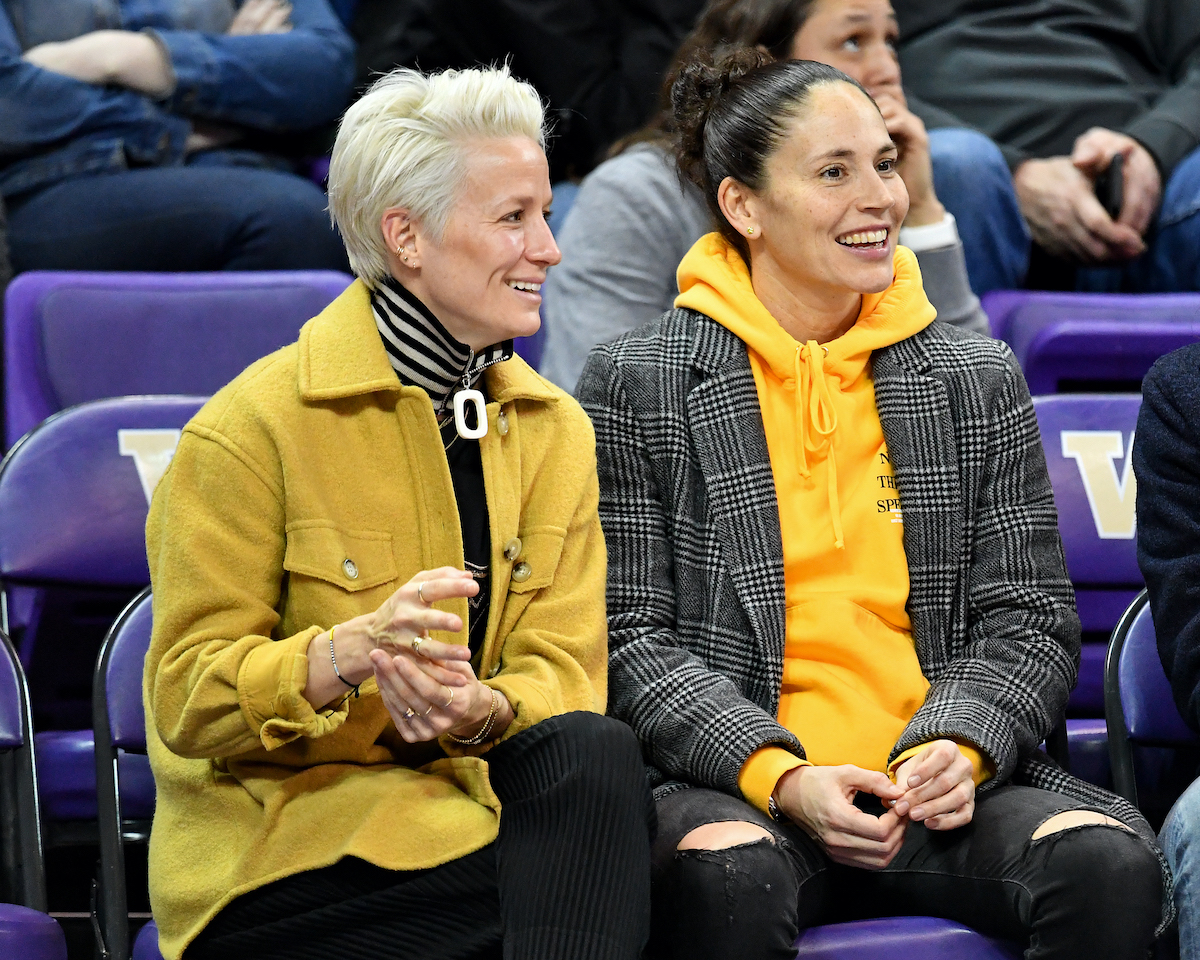 Power couple, USWNT forward Megan Rapinoe and Seattle Storm guard Sue Bird enjoy a basketball game