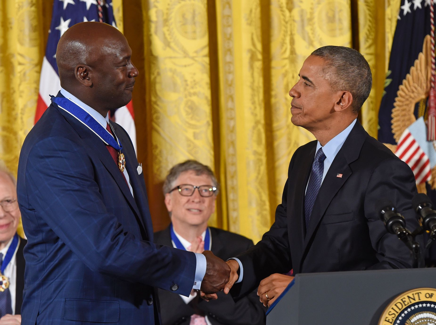 Michael Jordan (L) and Barack Obama (R), shake hands in the White House.