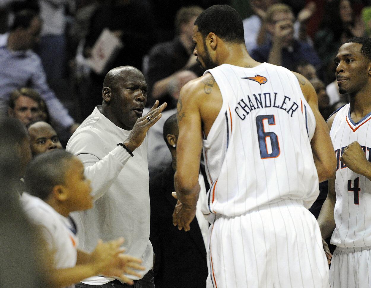Michael Jordan (L) bought the Charlotte Bobcats in 2010.