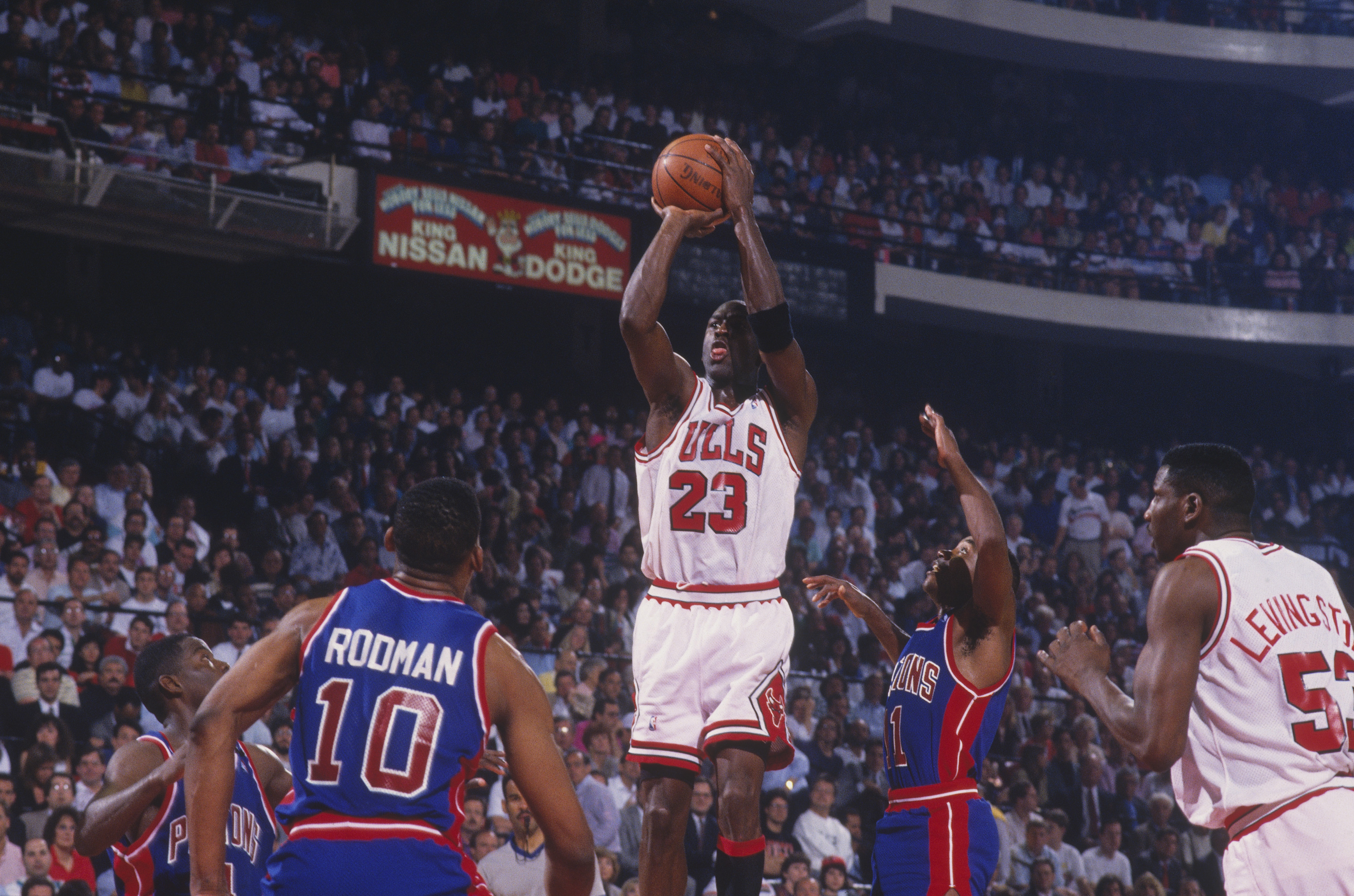 Michael Jordan of the Chicago Bulls jumps to shoot a basket against the Detroit Pistons