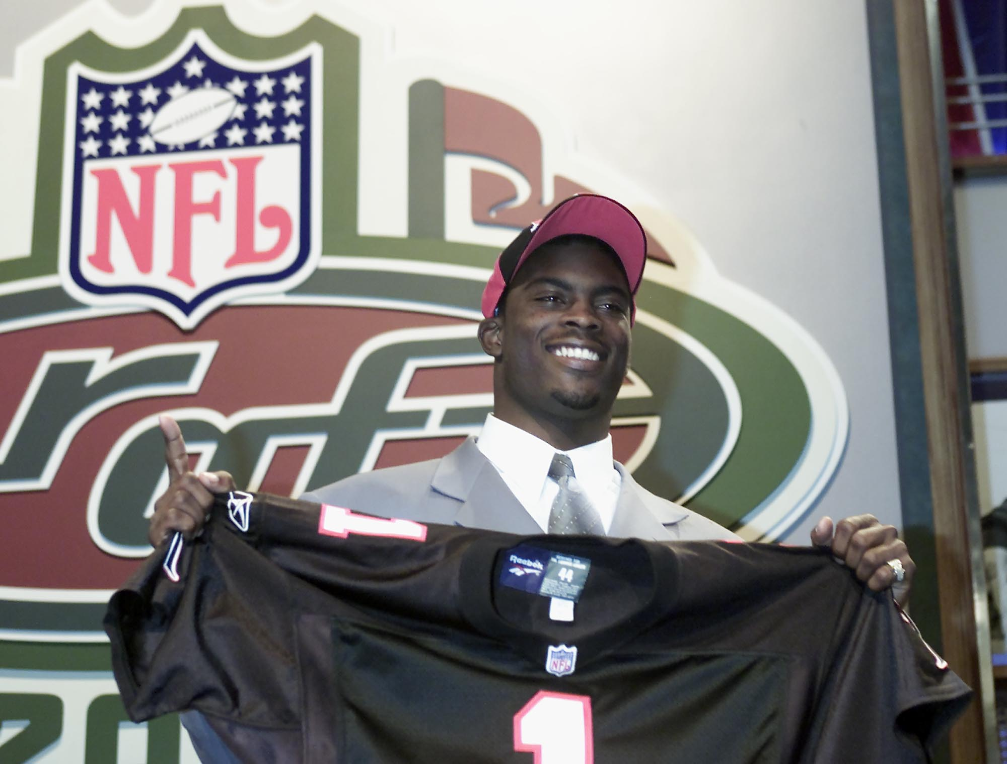 Michael Vick smiles after the Falcons pick him in the 2001 NFL draft