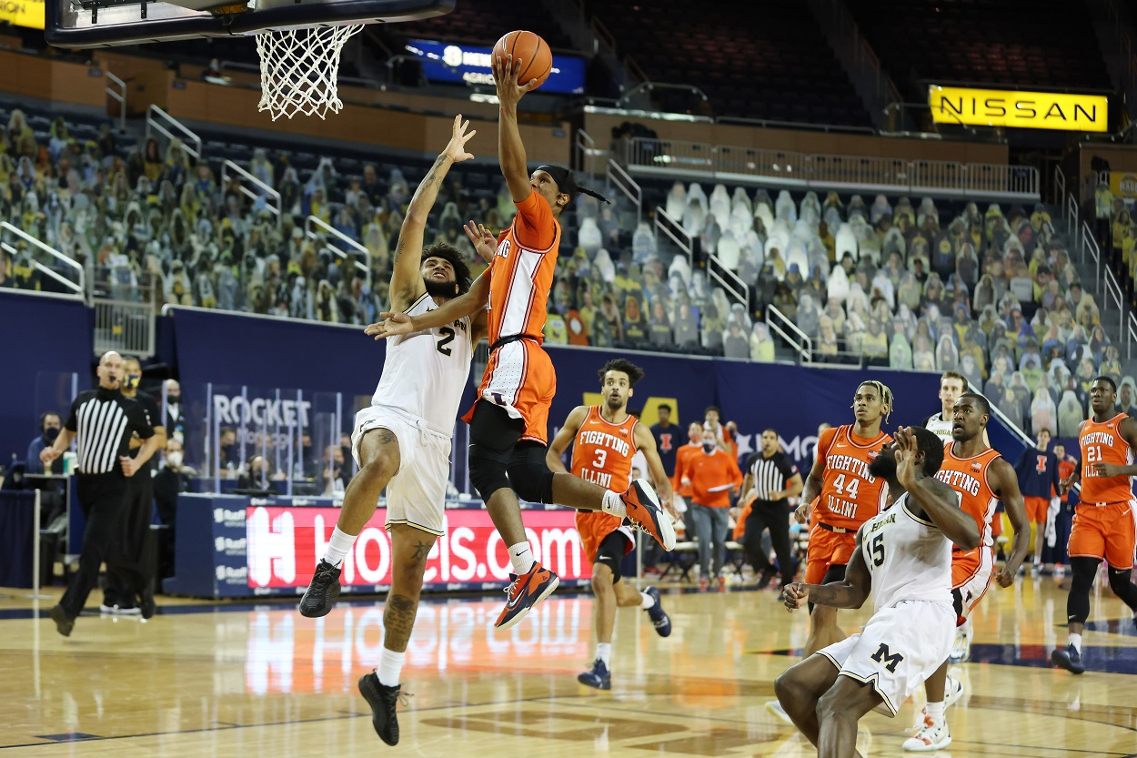 Illinois Fighting Illini guard Trent Frazier drives to the basket against Michigan Wolverines forward Isaiah Livers
