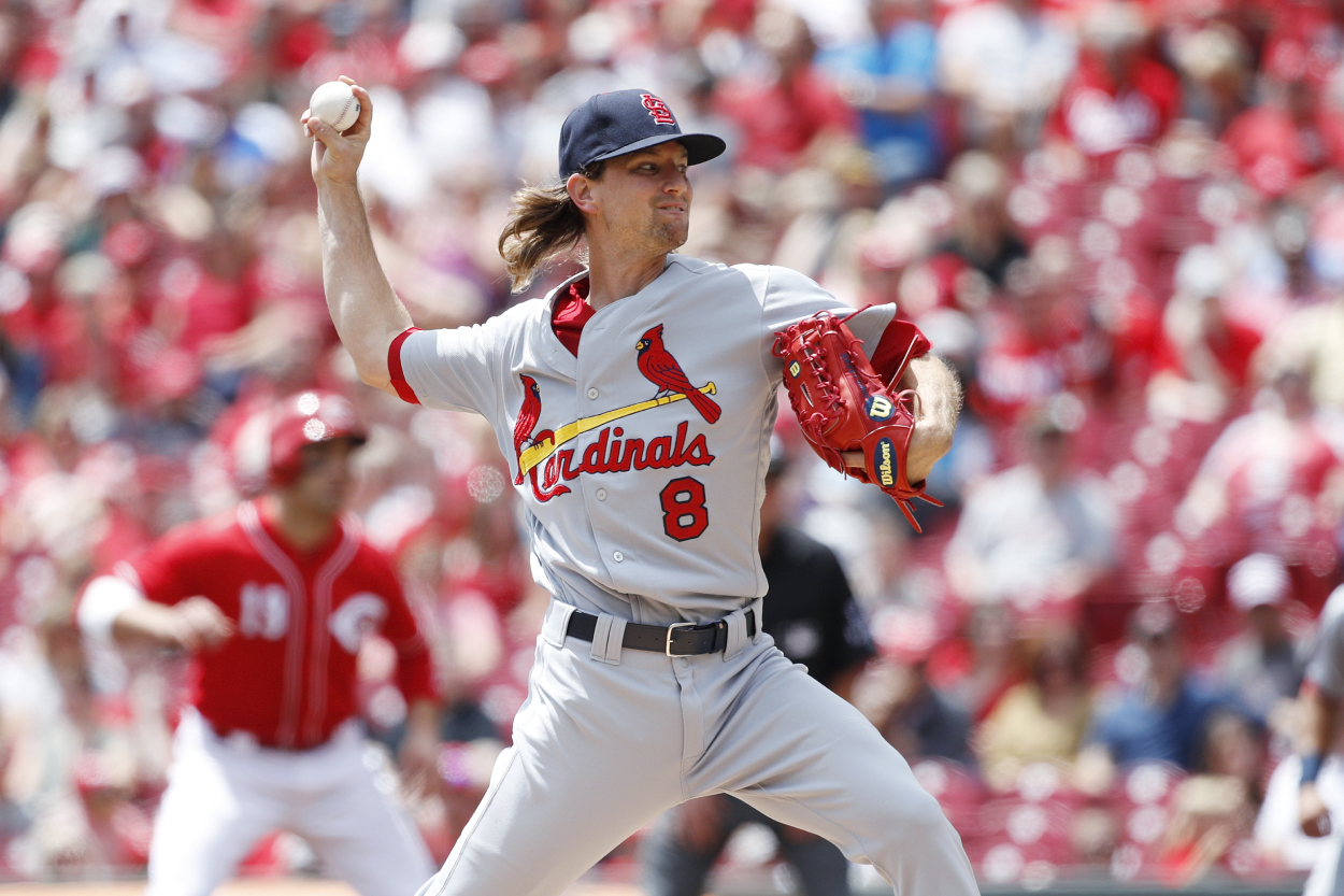 Former Reds and Cardinals pitcher Mike Leake playing in a game for the Cardinals against Cincinnati.