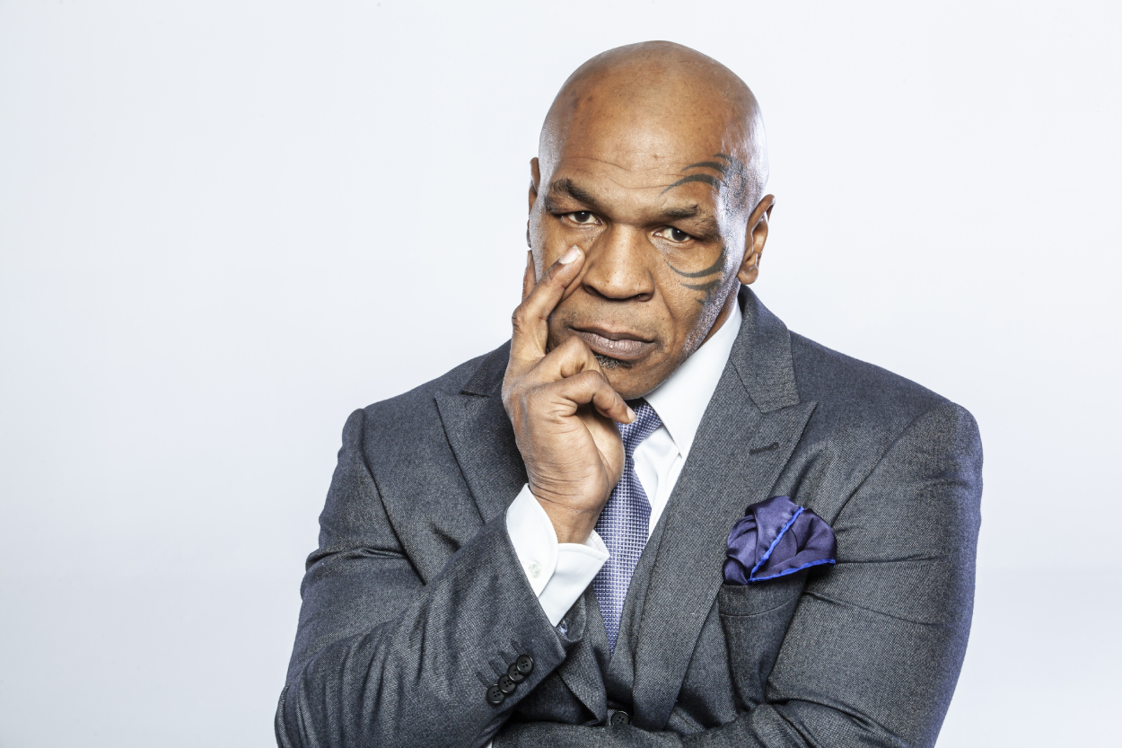 Mike Tyson poses for a photo in a suit