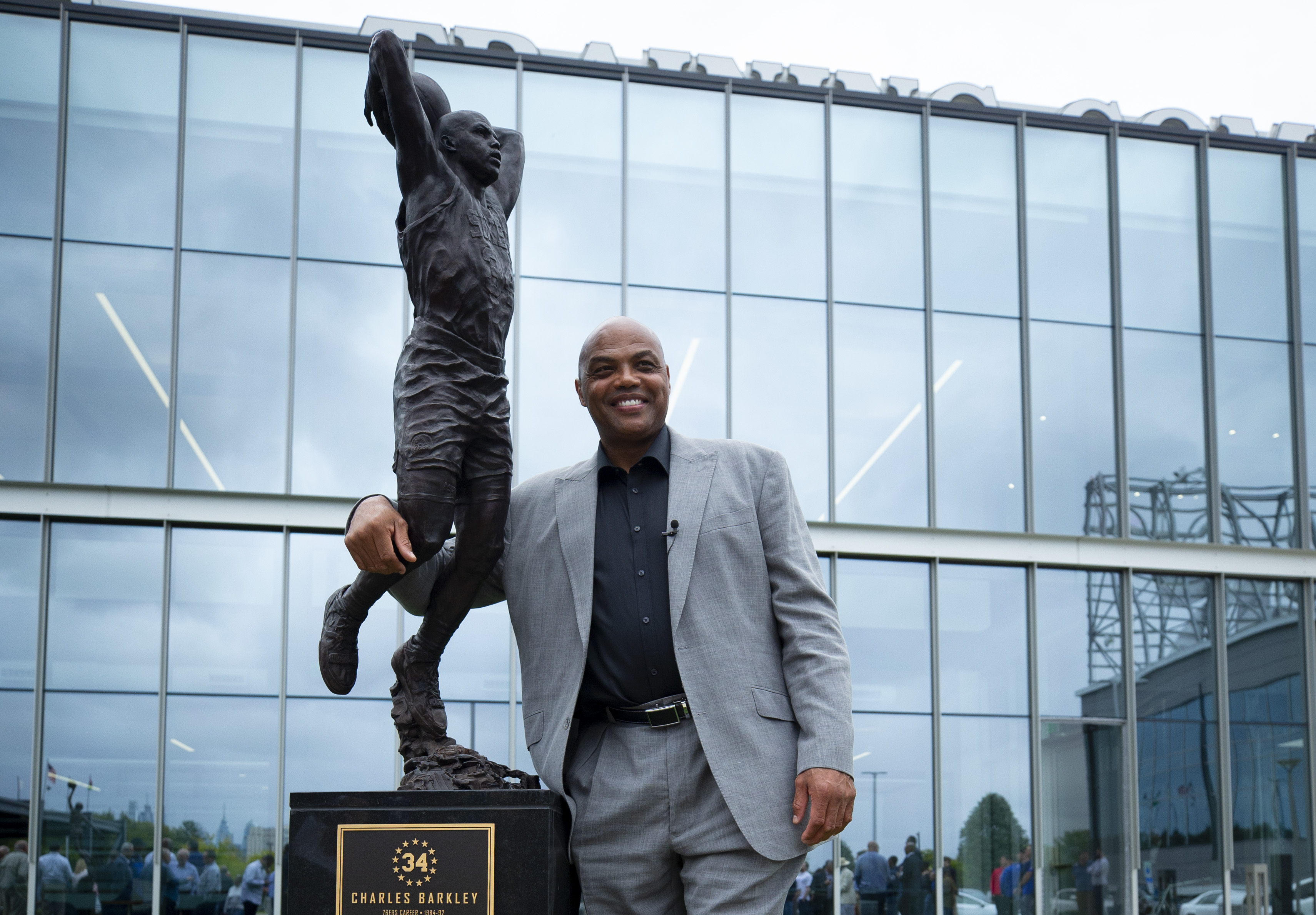 Charles Barkley poses for a picture with his sculpture at the Philadelphia 76ers training facility