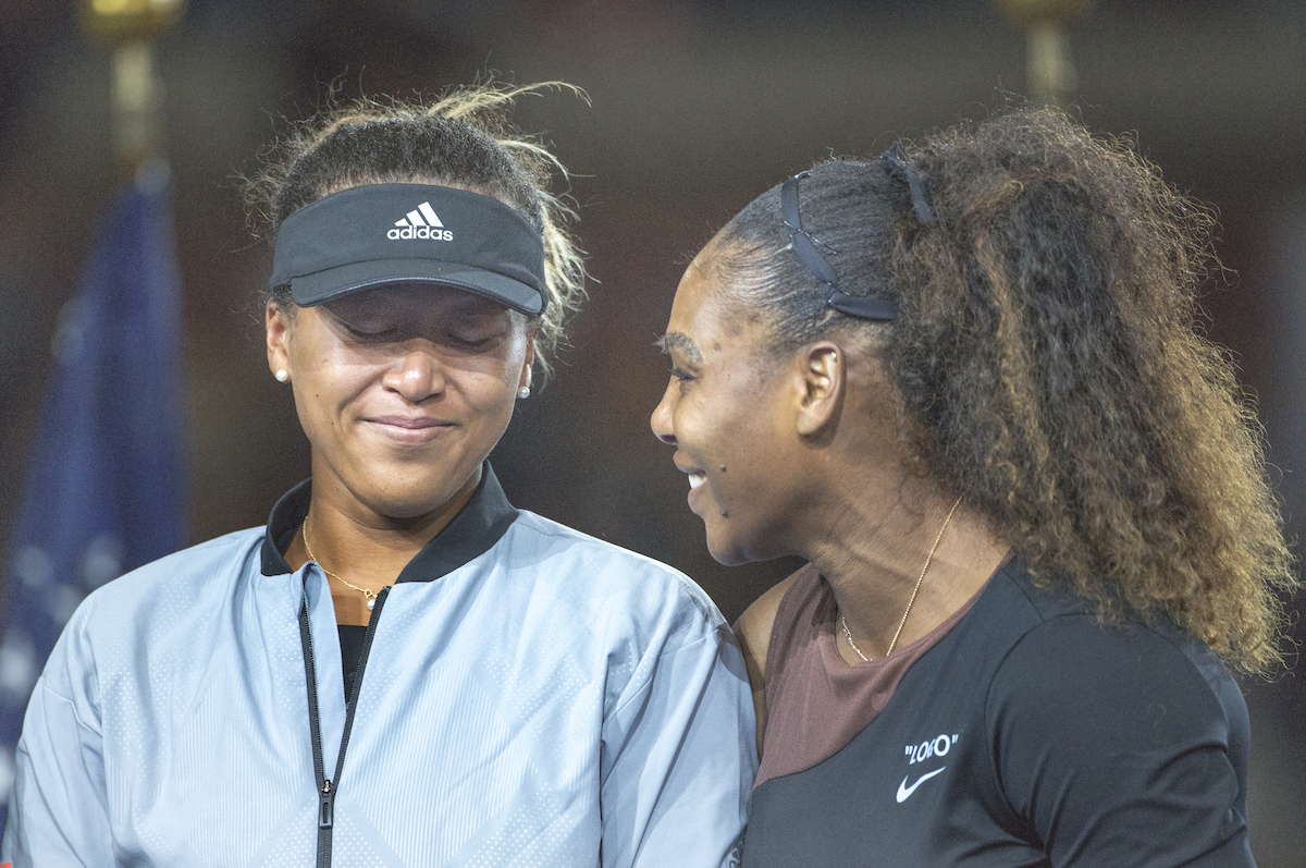 Naomi Osaka speaks with Serena Williams after winning the 2018 U.S. Open
